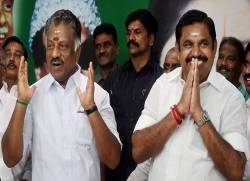 Chennai: Tamil Nadu Chief Minister K Palaniswami (R) and O Panneerselvam exchange greetings with supporters following merger of their factions in Chennai on Monday. All India Anna Dravida Munnetra Kazhagam factions led by Chief Minister Edappadi K Palanisamy, OPS, AIADMK