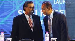 Anil Ambani (R), chairman of the Reliance Anil Dhirubhai Ambani Group, talks to his brother Mukesh Ambani, chairman of Reliance Industries Limited,