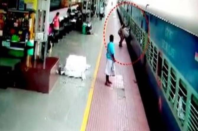 Railway Personnel saves passenger CCTV Video :