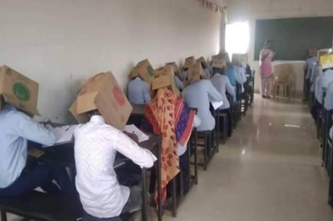 Karnataka college makes students wear cartons during exam to prevent cheating - தேர்வில் காப்பி அடிப்பதைத் தடுக்க உலக லெவல் அட்டெம்ப்ட்! டென்ஷனான அமைச்சர் (வீடியோ)