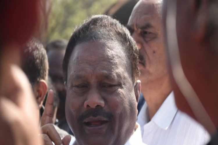 dindugul sreenivasan, minister dindugul sreenivasan, elephant camp, mudumalai tiger reserve, tribal boy, complaint, police, inaction