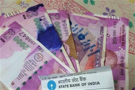 SBI accepts old damaged currency notes