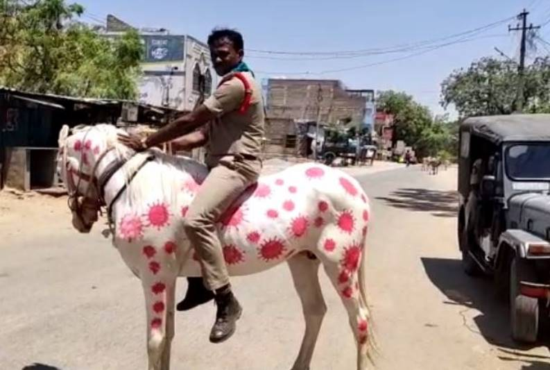 AP Cop Painting Horse with COVID-19 Images to Create Awareness
