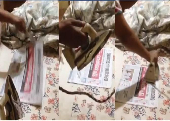 viral trending video of iron pressing newspaper amid corona outbreak