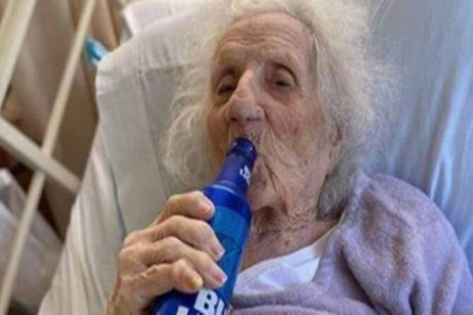 103-year-old woman celebrates with beer after beating COVID-19