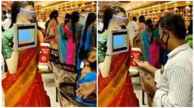 textile showroom women robot provides sanitizers, tamil nadu textile showroom, women robot provides sanitizers to customers, தமிழ்நாடு ஜவுளிக்கடை, வாடிக்கையாளர்களுக்கு சானிடைஸர் விநியோகிக்கும் பெண் ரோபோ, பெண் ரோபோ, வைரல் வீடியோ, women robot in saree, robot detects customers provide hand sanitisers, viral video, tamil viral news, tamil viral video news, latest trending video, technology videos