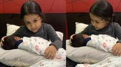 Sakshi Dhoni shares pics of daughter Ziva holding a baby