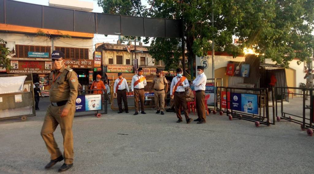 In Kumbh crowd management, a first: RSS workers as Special Police Officers