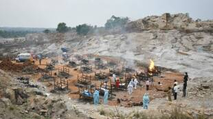 Bengaluru city covid updates Tamil News: Bengaluru crematoriums running out of space, pyres burn at granite quarry outside city
